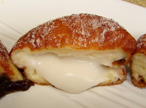 Leonard's of Hawaii - Haupia (coconut) Malasada Puff.... drooool.....omg I want one! I miss eating them!