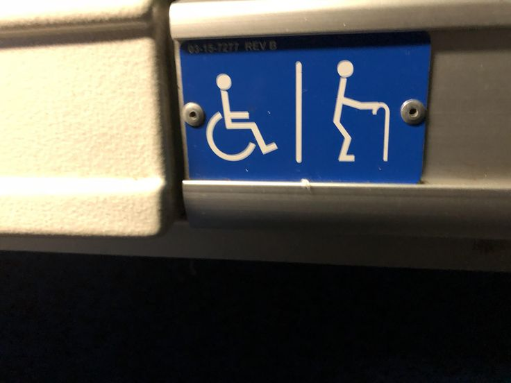 This reserved bus seat has both handicapped and elderly indications.