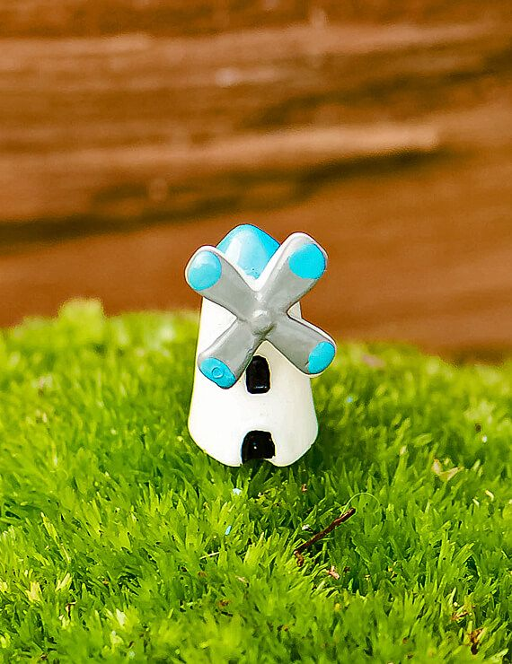 """The Mini Windmill terrarium accessory helps animate and blow some life into into your terrarium.  Simply adorable.  Everyone will love it!  Use with lichen, moss, tropical plants and ferns.•Approximate size- (½""""x ½""""x ¾"""").•CONTAINS NO PLANTS, SOIL OR ROCKS.  (Product for sale is just the windmill)."""