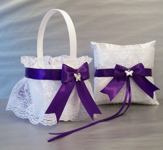The satin flower girl basket features a pretty ruffled lace, trimmed with satin ribbon, and embellished with handmade satin bows made out of 1.5