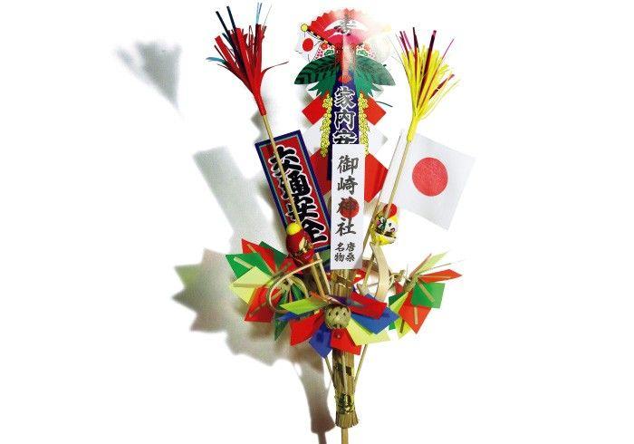漁業の神様として知られる宮城県唐桑半島の御崎神社より。竹のバネで上に弾くことができる、小さな猿の人形がついた縁起物。漁船に振りかかる厄災を弾き飛ばす。