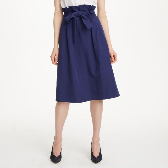 """The Dilys features a paper-bag waist and structured A-line silhouette, creating a polished aesthetic that works with a blouse for the office or a tee on the weekend. Modal/linen blend  A-line silhouette 29 ¾"""" in length based on a size 6 Paper-bag waist; optional self-tie belt; belt loops; concealed zip with hook-and-bar closure at the front; side seam pockets Online exclusive Dry clean Imported"""