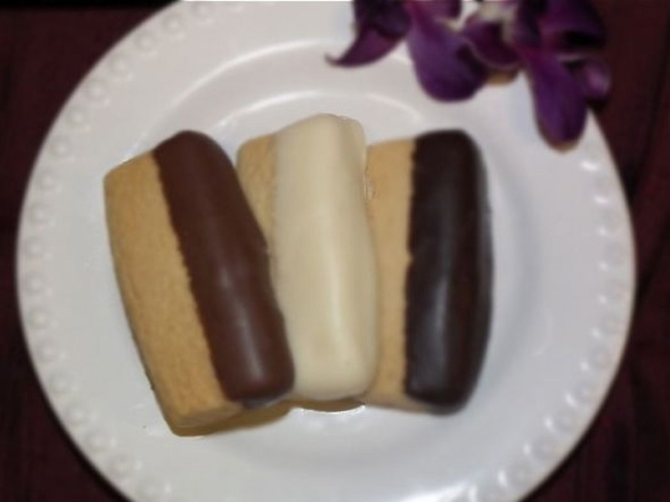 Big Island Delights Chocolate Dipped macadamia nut shortbread. Nom nom ...