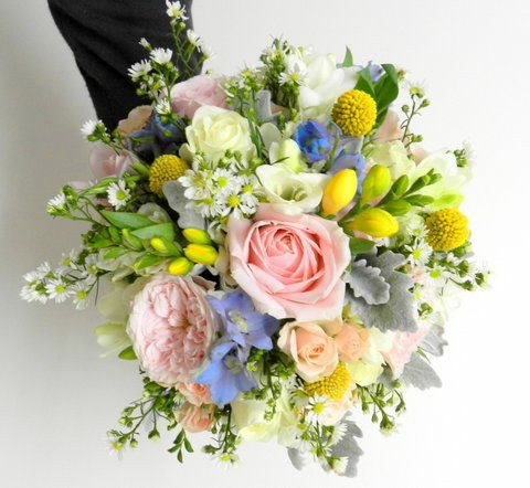 colourful bridal bouquet with pastel blue delphinium soft pink roses & yellow freesia, designed by Tiffany's flowers.
