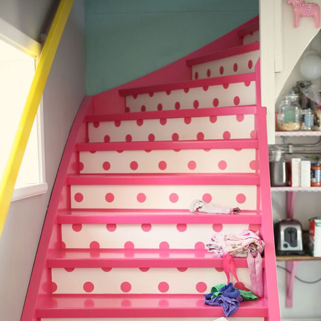 25 Brilliant Ways to Decorate Your Stairs via Brit + Co. Polka Dot Stairs: While the combination of the pink and polka dots might seem a touch girly, we like the concept and would love to see it done in black and white with pops of brighter colors. (via Dos Family)