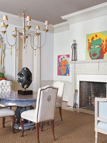 Dining Room Andy Warhol silk screens. Antique chairs in Donghia linen.  Antique mirror and