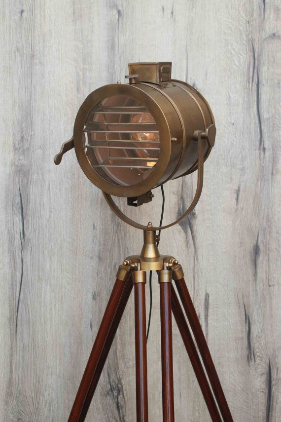 This vintage style designer wooden tripod floor lamp will add a bold statement to your home or office. This photographers tripod floor lamp is used by decorators just as often as it is used by actual photographers. It is generally known by various names like Vintage Floor Lamp, Essex Style Floor Lamp, Search Light, Tripod Lamp, Patrol Lamp, Spotlight Lamp and Hollywood Style Lamps. A lot of expensive furniture stores, high street retailers and interior designers are using the spotlight…