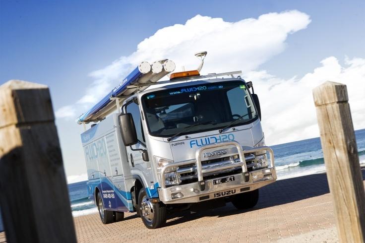 Isuzu Truck wrap, plumber's vehicle wrap, Fluid H20, metallic treatment