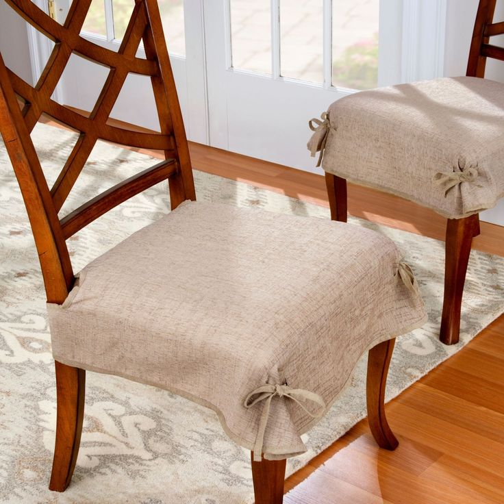 Instantly update your living room chairs with these sleek and stylish chenille covers. The set of two polyester furniture covers are easy to attach and tie to each chair legs to keep them from shifting. Each adjusts via a hook-and-loop strap for a custom fit. Did someone accidentally spill on one during the party? Just throw the chair cover in the wash and line dry. In 5 popular and elegant colors.
