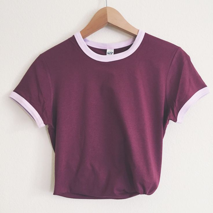 This gorgeous maroon tee with light pink sleeves is essential to your collection. Our ringer tees are a staple to any girl's closet, adding a touch of grunge. They look great styled casually with jeans and boots, or dressed up with a cute plaid skirt.