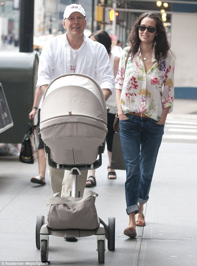 Baby's first shopping trip! Bruce Willis was doting dad as he took his wife Emma Heming and their four-month-old baby daughter Mabel out shopping in Manhattan today