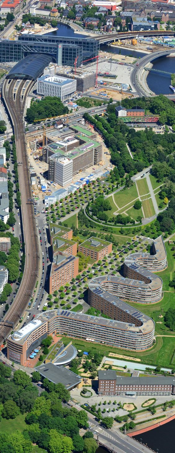 "Berlin Hauptbahnhof (Top) - Gerkan, Marg und Partners (2006) - The Berlin Main Train Station and Abgeordneten-Schlange (Bottom) - Georg Bumiller (1934) - An apartment complex for federal government employees and known to Berliners as ""Die Serpentine"" for obvious reasons. Situated in the locality of Moabit.:"