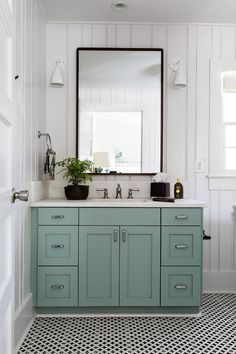 Picture Collection Website  under the marble sink with black framed mirror white sconces and black and white patterned floor tiles in this adorable country chic bathroom