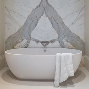 Stone One Free standing Bath. Gorgeous marble background