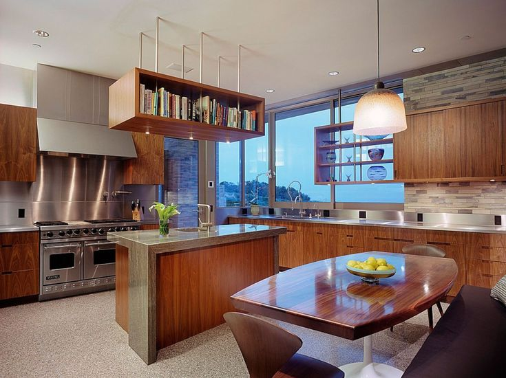 A very midcentury (modern) kitchen. I love the open shelves by the window and the ceiling.