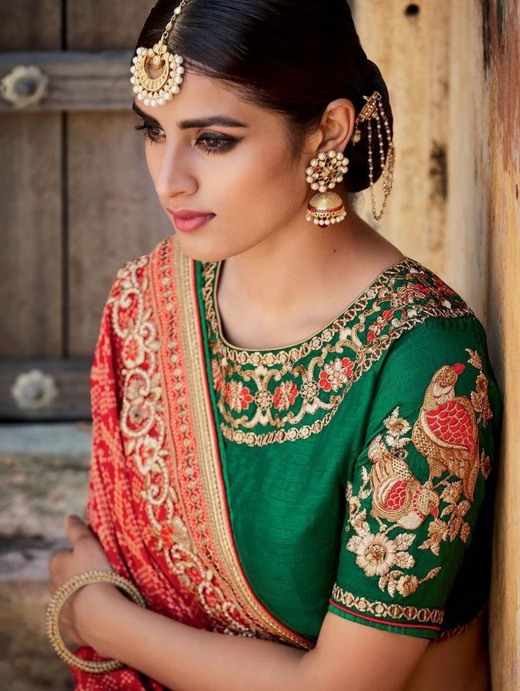 What a beautiful low bun with ornamental chains! Care however should be taken before adopting such hairstyles, as due to it's high static charge, it will cause phlegm to move up in the throat, causing the voice to quaver & a frequent urge to clear the throat. A heavy chabi chhalla with a long & wide hook if inserted at the edge of the pleats of the saree, will reduce this problem as it's hook will activate the acupressure points that act to keep the throat clear.