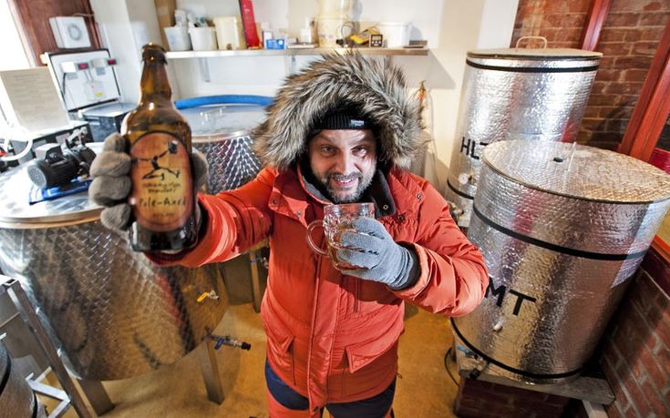 Rob Brown from the National Oceanography Centre in Southampton with a bottle of beer called Pole-Axed. Twenty pints of the ale are due to be shipped 10,000 miles to the British Antarctic Survey's base on Antarctica for engineers and scientists working there as the drink is able to withstand the extreme freezing conditions.  Picture: Robert Nemeti/Solent News