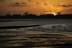 TWA-0043874 © WestPix Beyond the Boom in the Pilbara: The sun sets behind Port…