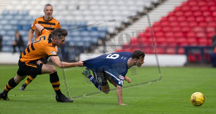 Queen's Park's John Carter held back during the Ladbrokes League One game between Queen's Park and Alloa Athletic.