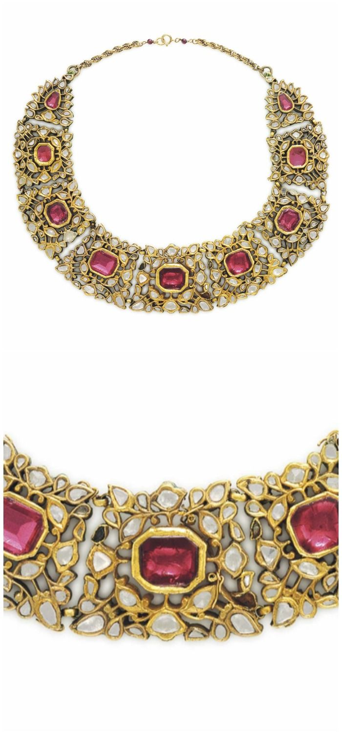 A NINETEENTH CENTURY DIAMOND AND SPINEL NECKLACE: Designed as a series of nine graduated table-cut diamond floral panels, each centering upon a pink octagonal-cut spinel, to the red, green and white enamelled reverse of foliate motif, Deccan, nineteenth century, 14 3/4 ins., mounted in gold. Via Christie's.