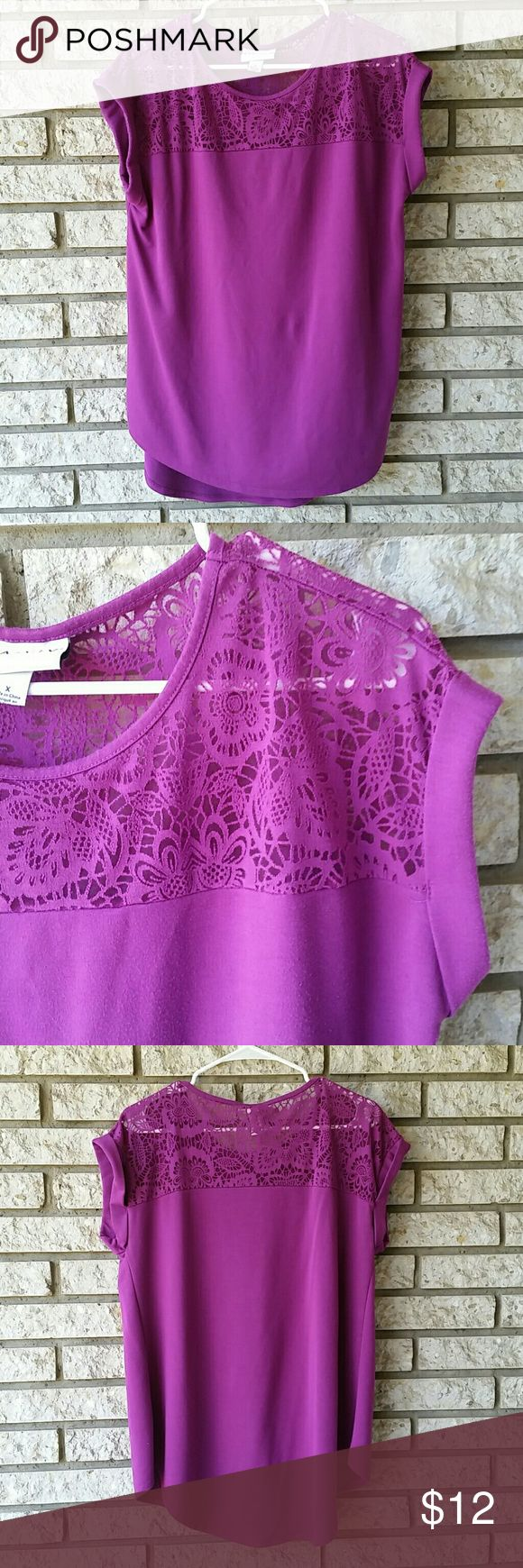 """Violet short sleeve tee with lace like detail This beautiful shirt is another I'm sad to part with as it helped me transition from one size to another! This is easily worn as a tunic with leggings or with pants or skirts. It dresses up and down well. The color is so vibrant and cheerful, I have yet to find this color in any other item of clothing yet! It says size X but I think it fits a lot like an xl other than the length. I'm 5'7"""" and loved having the extra length on this shirt. Ava Viv…"""