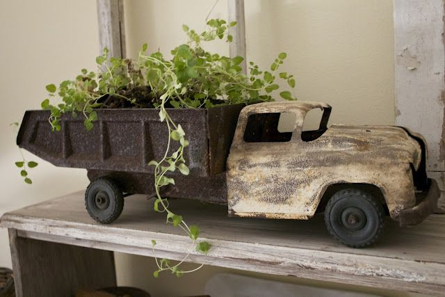 Old toys add such whimsey...and I love this dumptruck filled with greenery!!