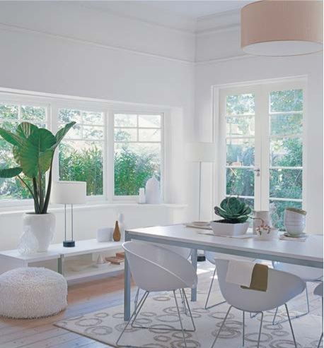 Living room - white on white using Dulux Antique USA on ceiling and on walls below picture rail