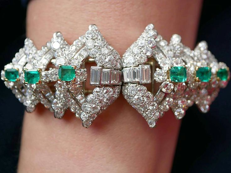Stunning Double Clips bracelet set platinum and gold with diamonds and emeralds by Cartier, circa 1920-1925
