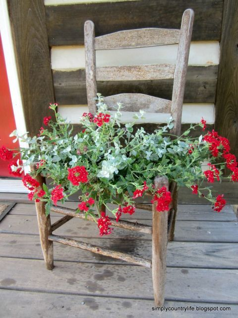Since the chair was already missing its seat, she stapled chicken wire over the open area and transformed it into a rustic flower planter for her front porch. Get the tutorial at Simply Country Life.