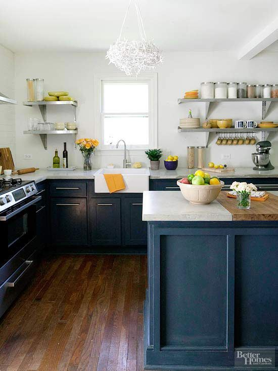 A little 1950s Cape Cod cottage gets a one-of-a-kind kitchen packed with personality. The farmhouse style balances more modern accents for an eclectic feel./