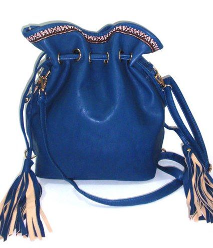 Blue duffel bag  and backpack with two side tassels and a fabric lace detail on the top, also two side pockets._fashion woman accessories.