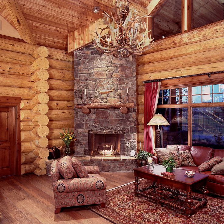 Decor Log Cabin With Sofas And Wooden Table Also Floor  Carpet Decorating Chandeliers Resemble Deer Antlers Fireplace Glasswindow Stone Wall 145 best Living room ideas images on Pinterest homes
