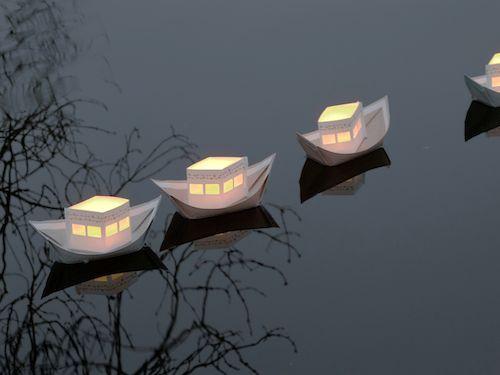 'rite de passage' folding paper light boats designed by jurianne matter http://www.zonnelijk.co.uk/paperboats