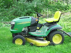 A John Deere lawn mower in a Finnish garden.