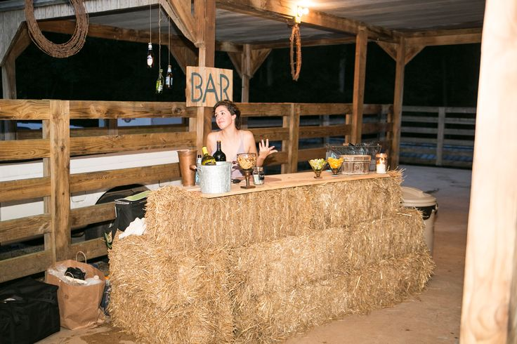 "Fitting with their rustic theme, the couple had a bar made of hay bales. ""Our friends really enjoyed the laid-back lifestyle and our family was very instrumental in helping us decorate for the celebration,"" says Karen."