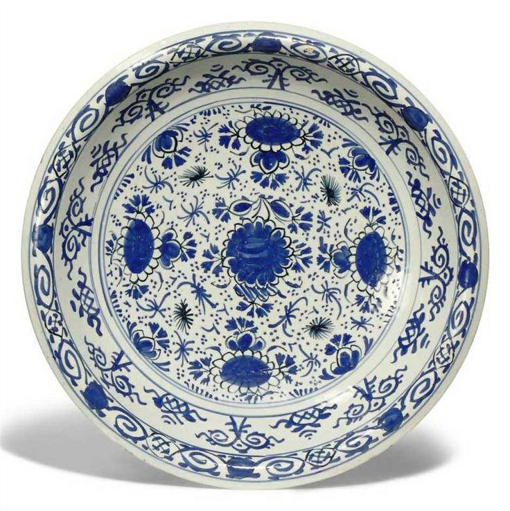AN ENGLISH DELFT BLUE AND WHITE DISH -  CIRCA 1720, PERHAPS BRISTOL