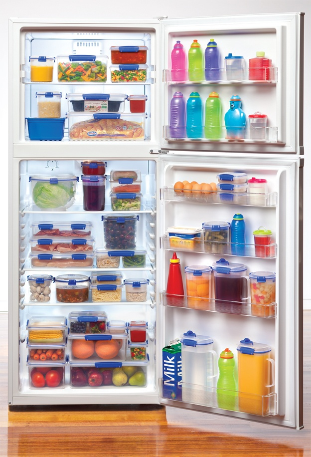 Picture from Sistema featuring KLIP IT® food storage and beverage containers in a refrigerator.  This picture really highlights how these containers can be organized to keep your food fresh and easy to find in the refrigerator!  Photo courtesy of Sistema.  #Sistema KLIP IT