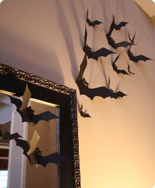 Cut out and bend...attach to wall with tape...cute!!!  Here are free Bat Templates  http://thingsorganizedneatly.tumblr.com/post/1271576248