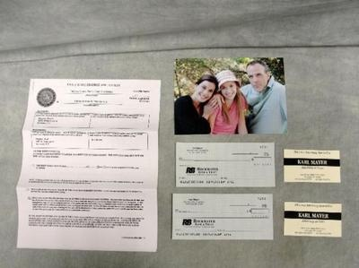 Desperate Housewives          This unique prop set is from the television show Desperate Housewives.         This is a screen used Karl Mayer prop set. The prop set includes:        Photo of Karl, Susan and Julie Mayer.   Two Karl Mayer Rockwater Bank & Trust Checks.   Two Karl Mayer Business Cards.   Susan Mayer's Eagle State Divorce Application Against Karl Mayer.  Note, Susan and Karl's names are spelled as Meyers in the document.