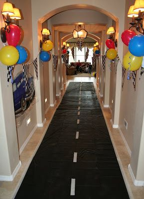 Make a 'Road' Out of a Black Plastic Tablecloth with Yellow or White Duct Tape