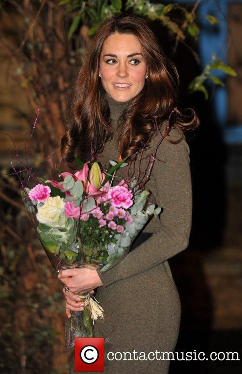 Kate Middleton December 2011 - William and Kate visits a charity that he now heads which was started by his mother the late Princess  Diana.