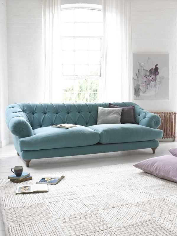 The button on front AA. editorial teal sofa