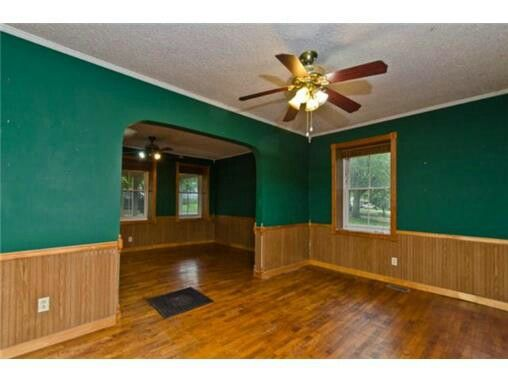 Natural Wood Wainscoting With Wood Floors And Dark Green