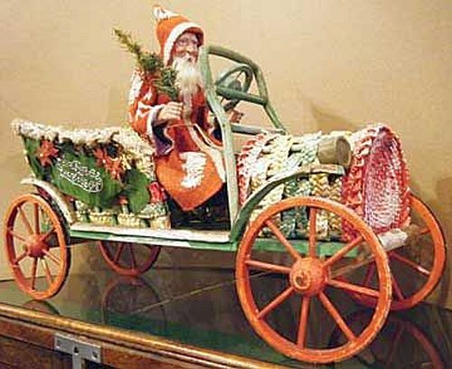 German Santa Doll Driving a Snow Covered Wicker Auto 1920.
