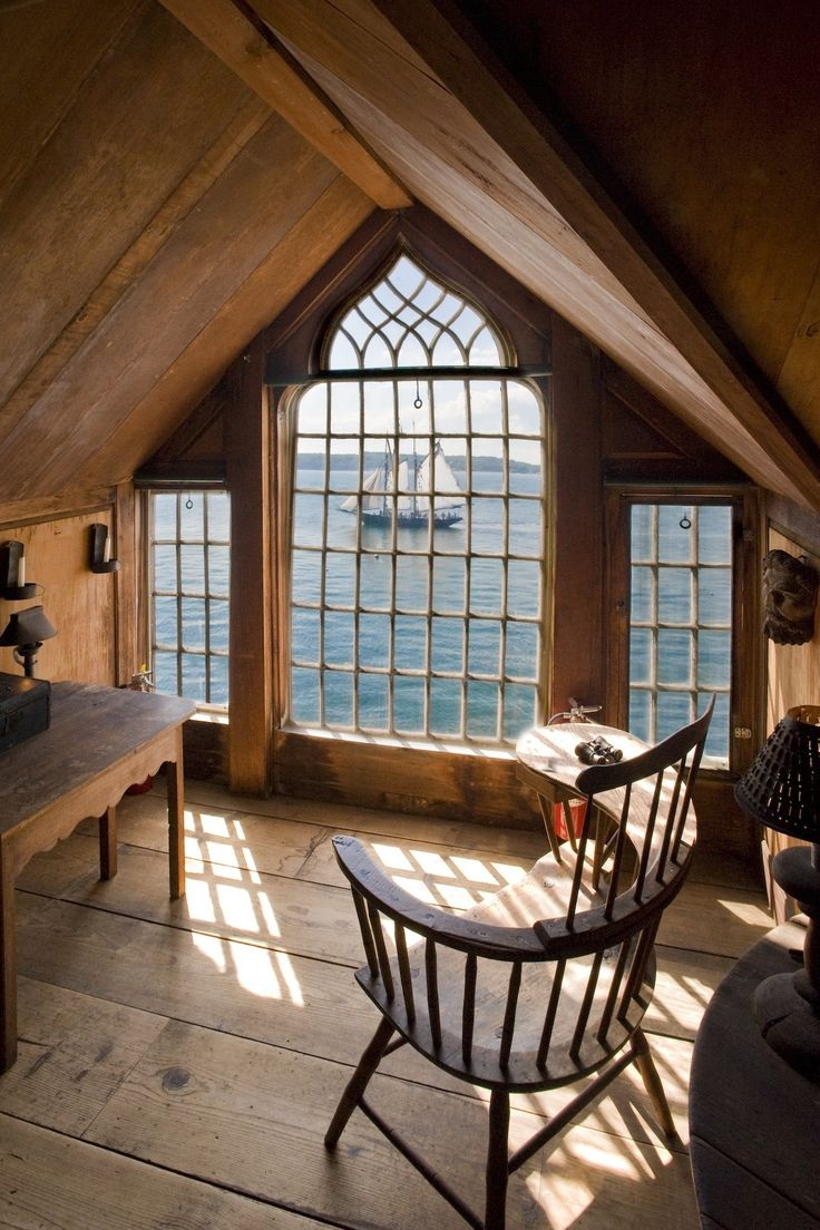 Just looking at this picture makes me wonderfully happy. I want an attic turned into a reading area with a window like this!