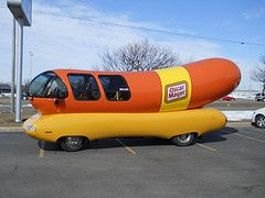 Check out the Hotdogger Blog to follow the exploits of the Oscar Mayer Wienermobile. The Wienermobile is a brand icon. Although it has been updated, the company has retained this classic vehicle's color scheme and logo over the years, creating a cult classic.