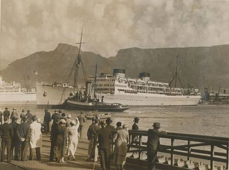 Waving goodbye to family and friends as a Union Castle ship leaves Cape Town.