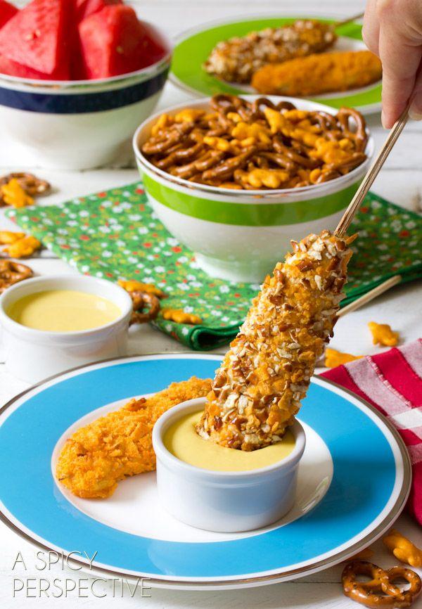 Cheesy Pretzel Chicken Pops - Kid-friendly baked chicken tenders recipe is loaded with flavor and fun to make! Cheesy Pretzel Baked Chicken Tenders on a