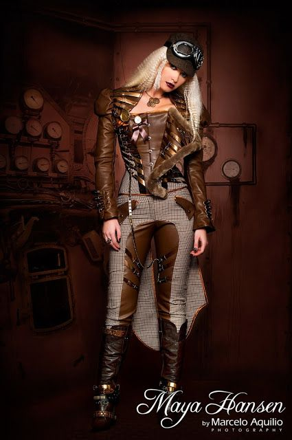 Steampunk Airship Pilot - Menswear inspired coordinating 3 piece outfit: brown leather corset with fur trim, tail coat in leather and menswear fabric, jodhpurs (riding pants) in menswear fabric and leather. All pieces accented with gold leather buckle straps. Jewelry: gear necklace, rings, pocket watch. Accessories: menswear baseball cap, goggles, tall brown leather boots - For costume tutorials, clothing guide, fashion inspiration photo gallery, calendar of Steampunk events, & more, visit…