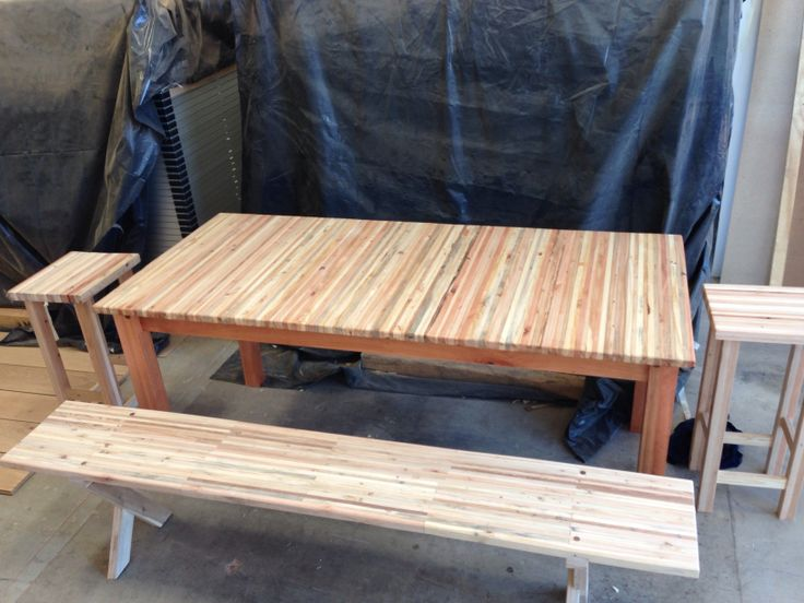 Solid laminated pallet wood table with red saligna legs
